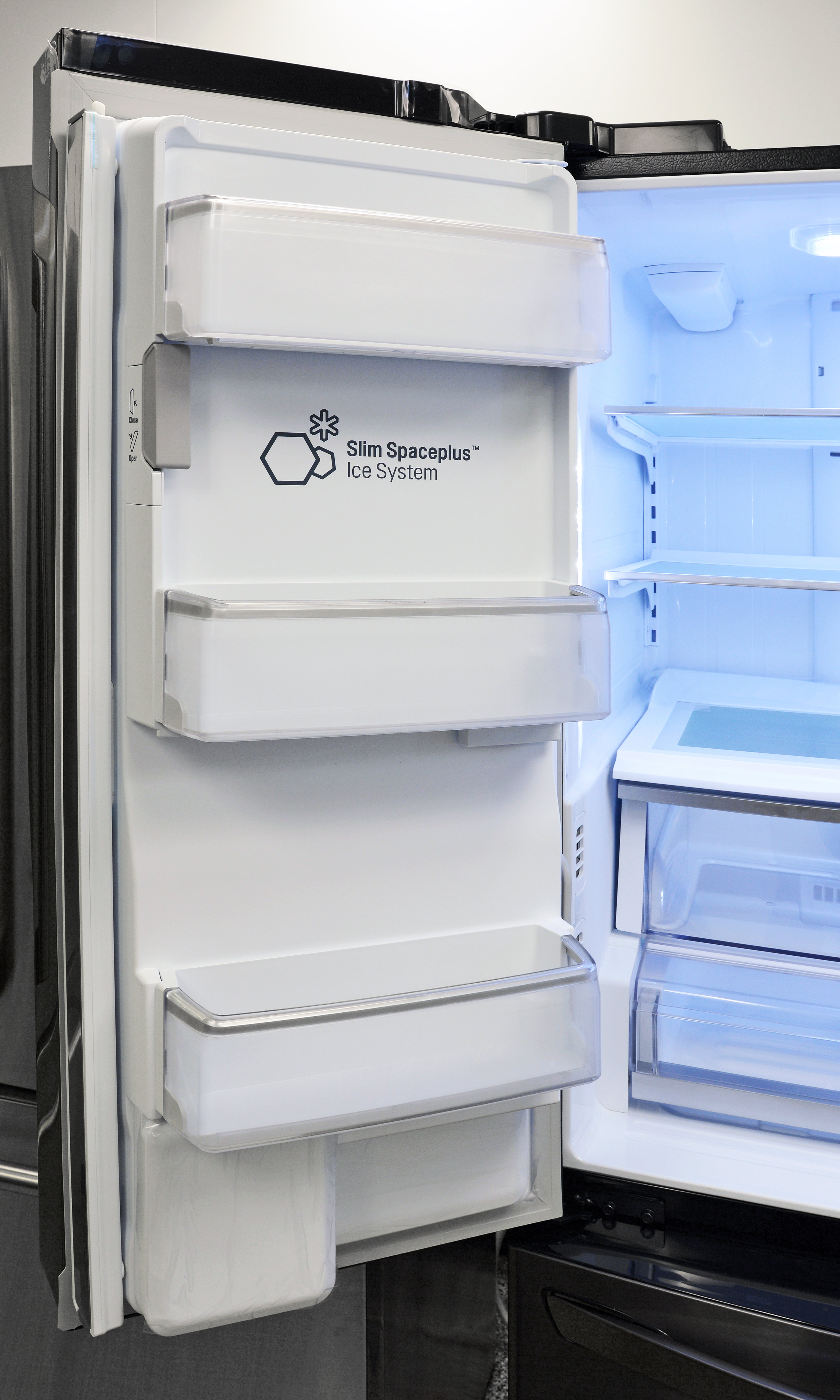 The left fridge door has some shallow storage available, as well as the slim ice maker.