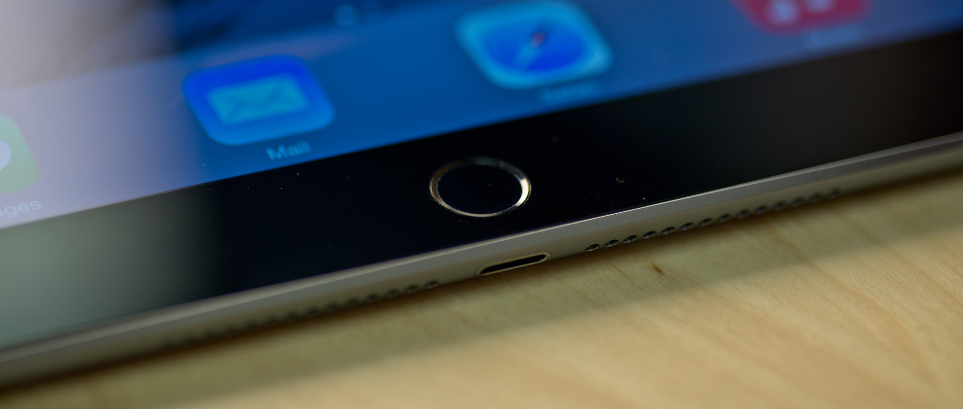 A photograph of the Apple iPad Air 2's home button.
