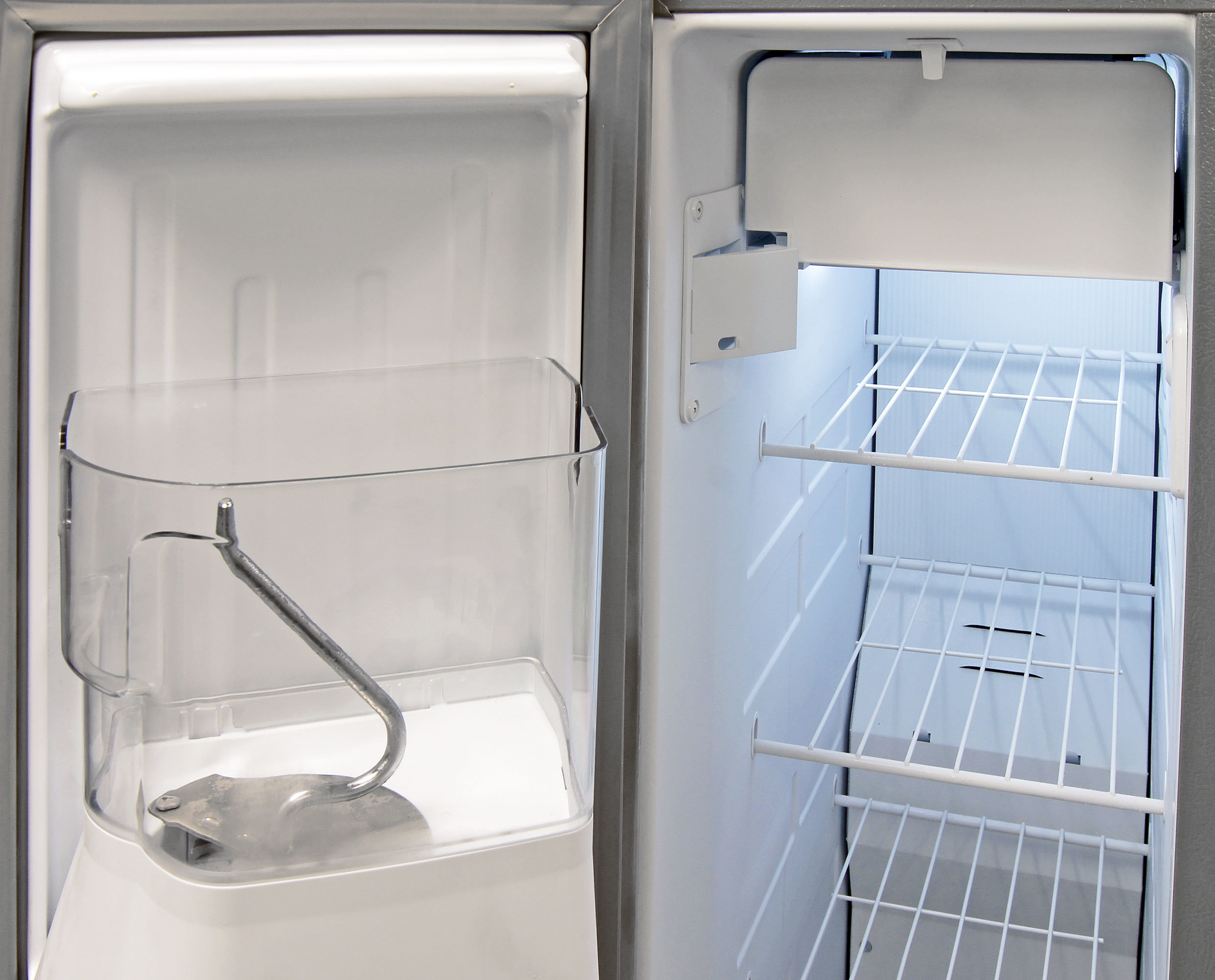 To accommodate for the slightly smaller size of the KitchenAid KSF22C4CYY, the icemaker is split into two parts. It's unlikely that you'll ever have to touch anything but the bucket on the door.