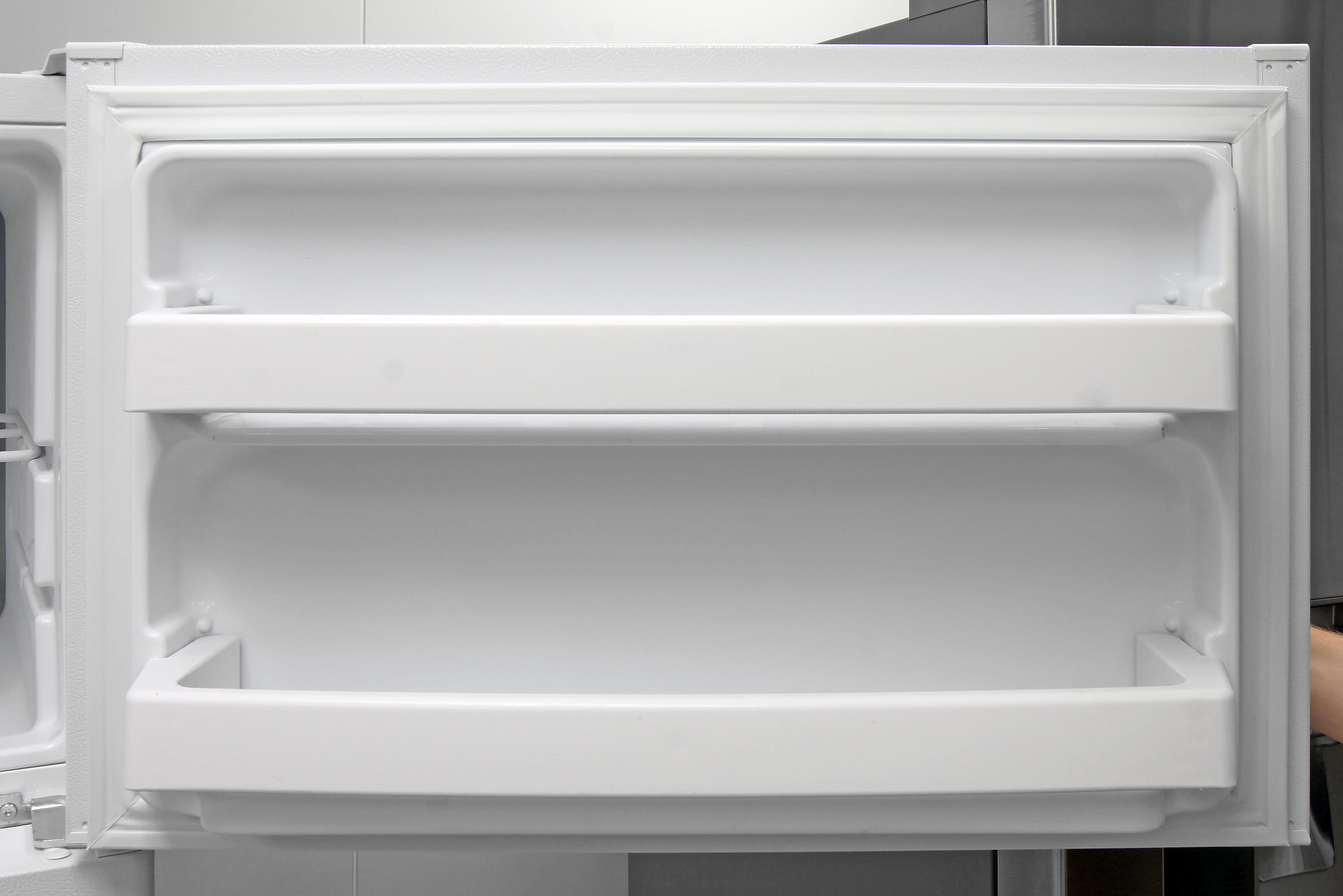 Fixed shelves on the GE GTS16DTHWW's freezer door add supplemental smaller item storage.