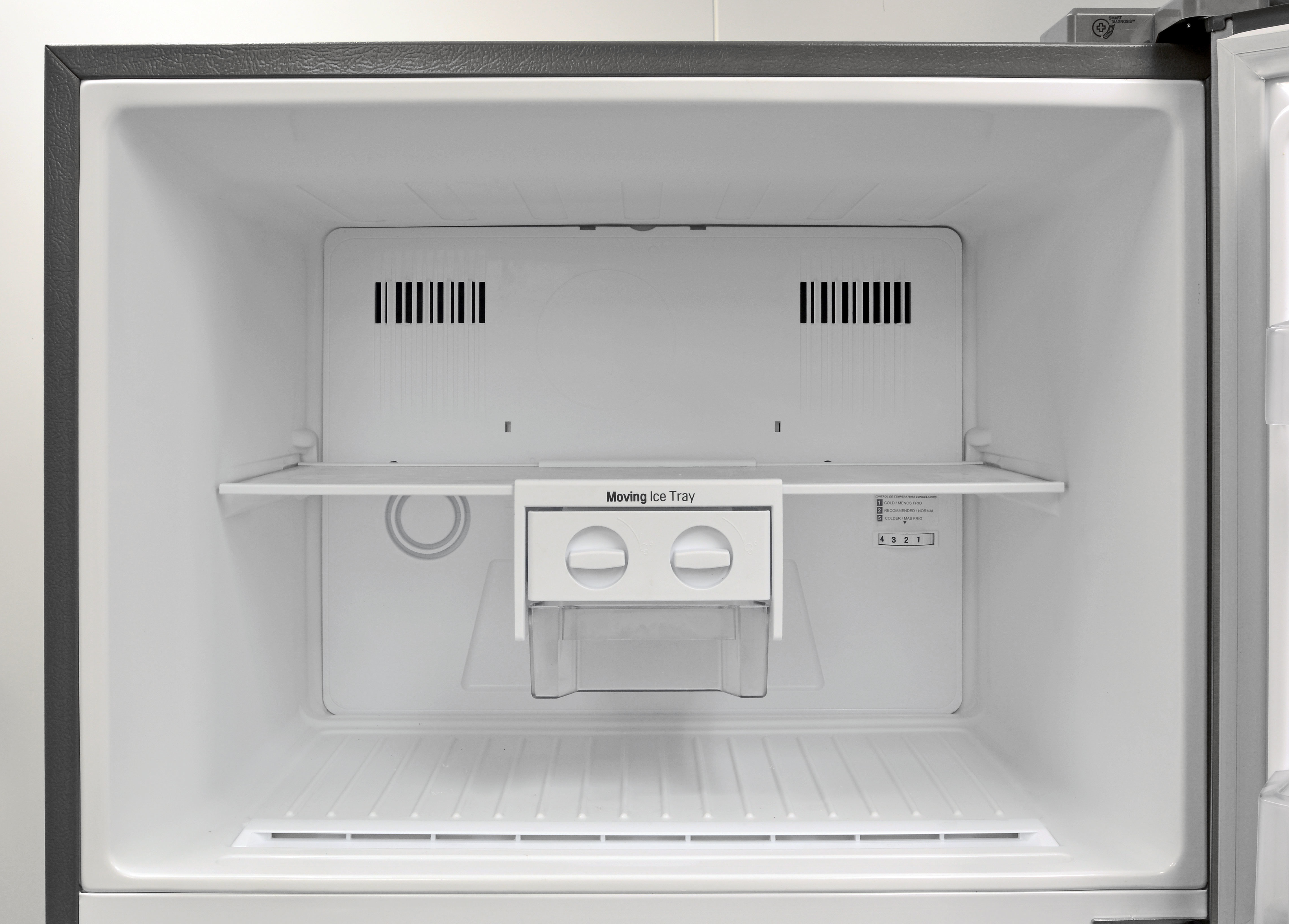 The LG LTNS16121V's basic freezer lacks a light bulb, but it does include a sliding bin complete with two small ice cube trays that you have to remove to fill.