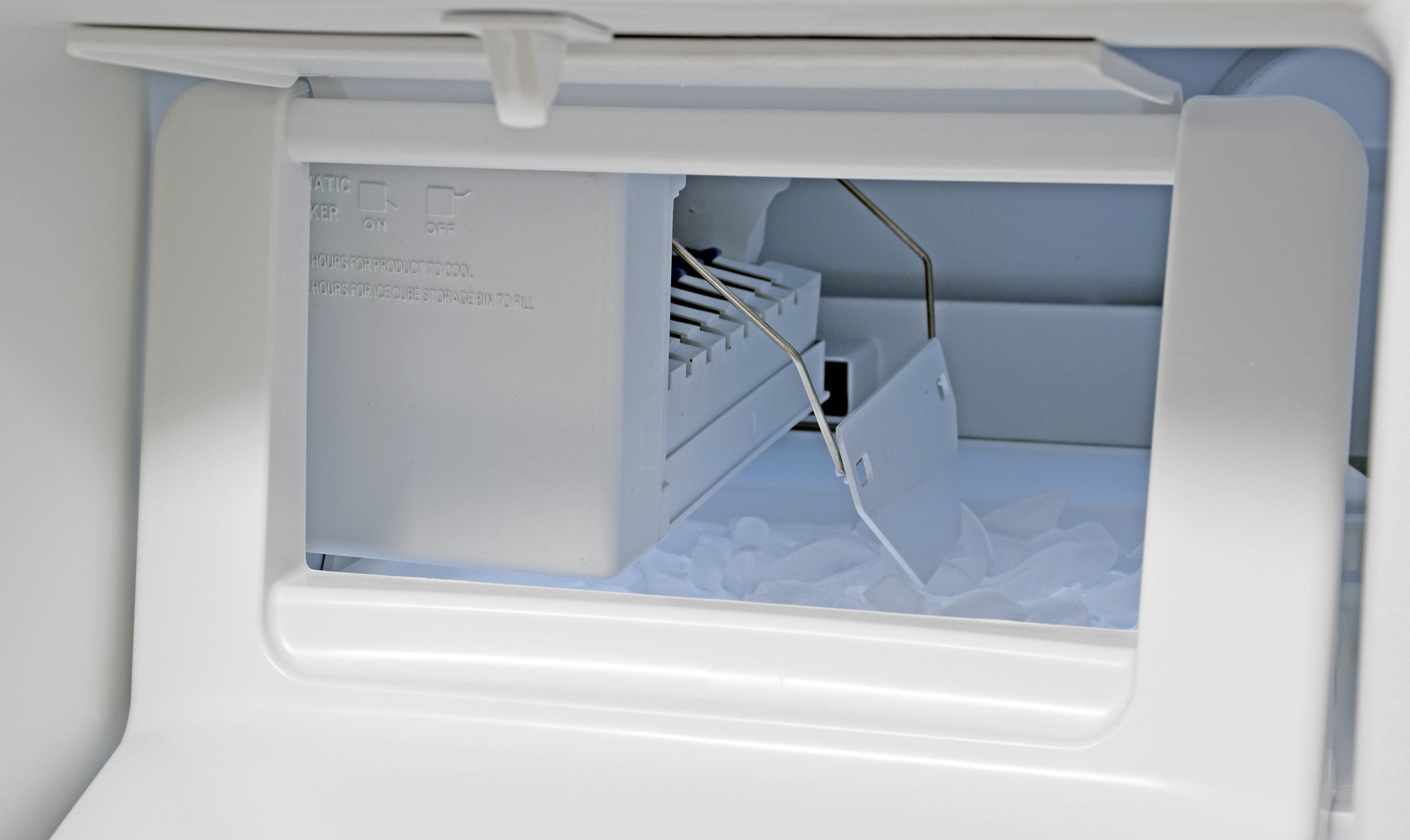 The front flap on the Kenmore 51122's icemaker is more convenient for turning it on or off rather than getting bulk ice.