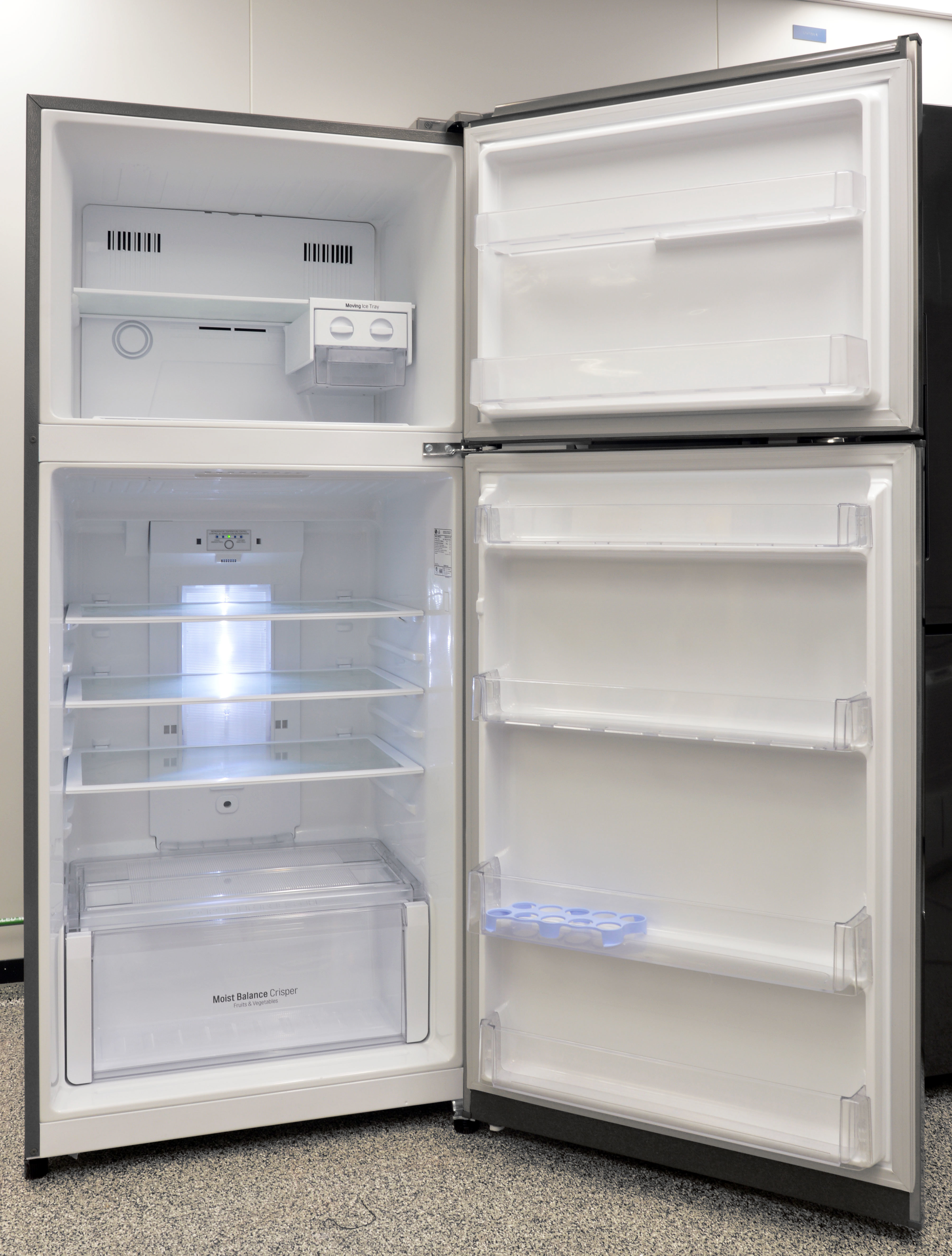 The clean white interior of the LG LTNS16121V's fridge isn't terribly large, but it makes the best use of the space it has.