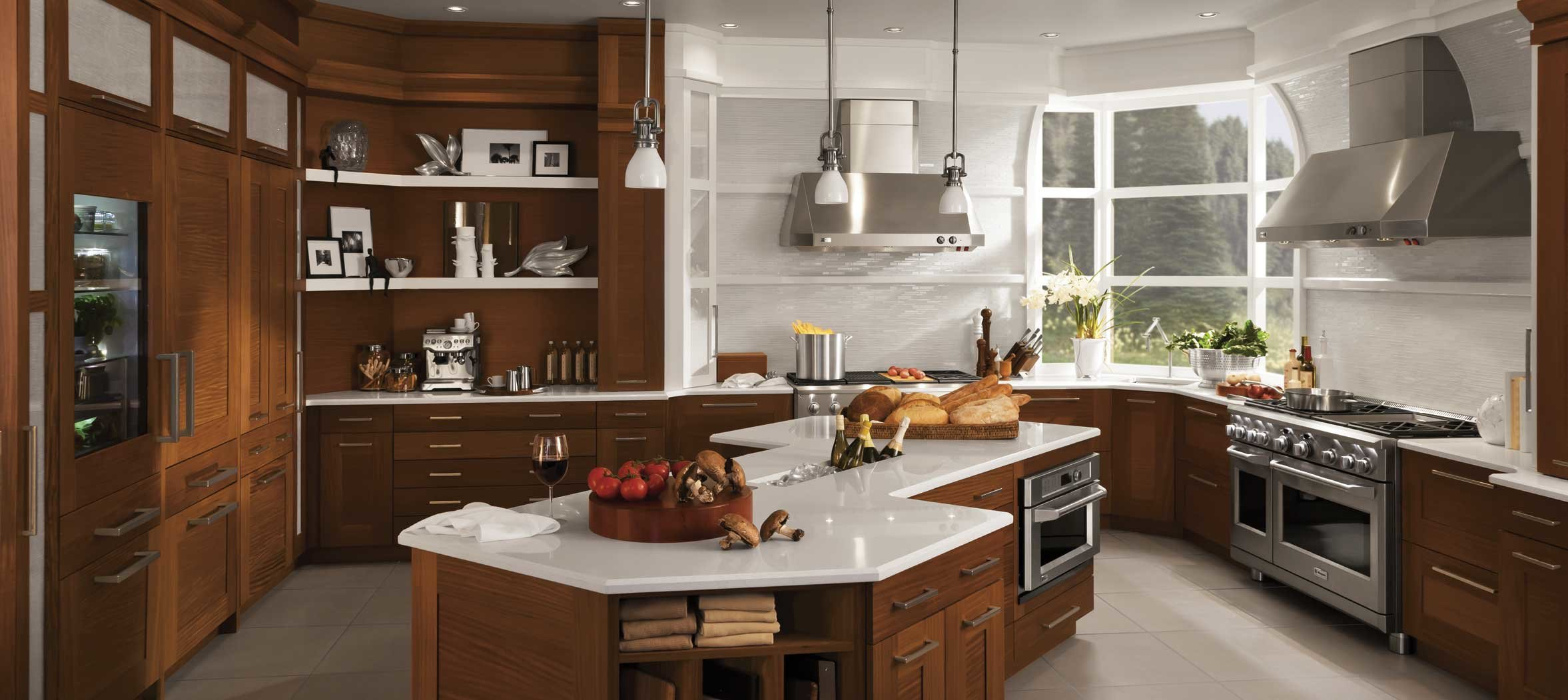 A bright, transitional kitchen designed around a Monogram range.