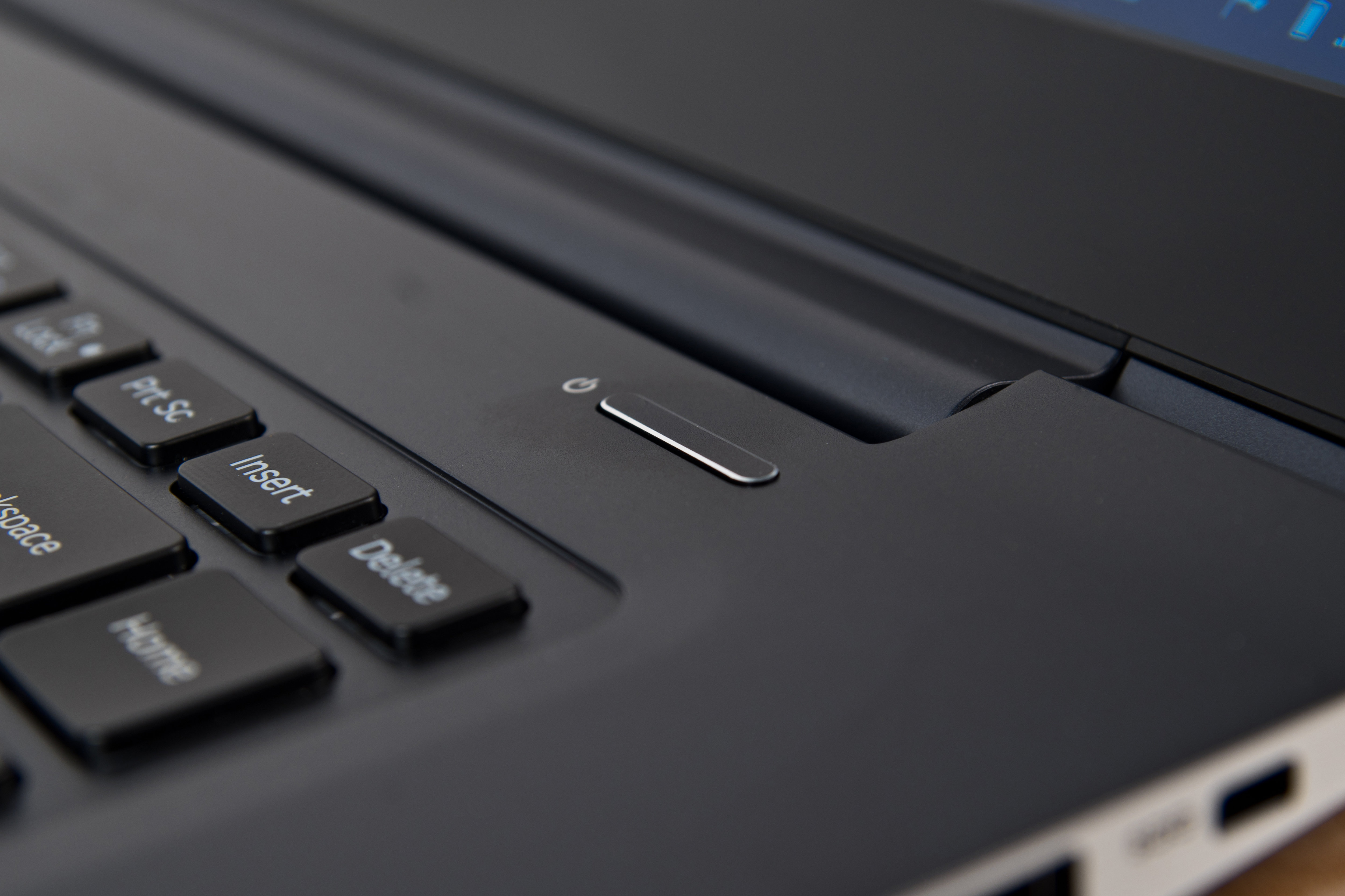 A photograph of the Samsung ATIV Book 9 2014 Edition's power button.