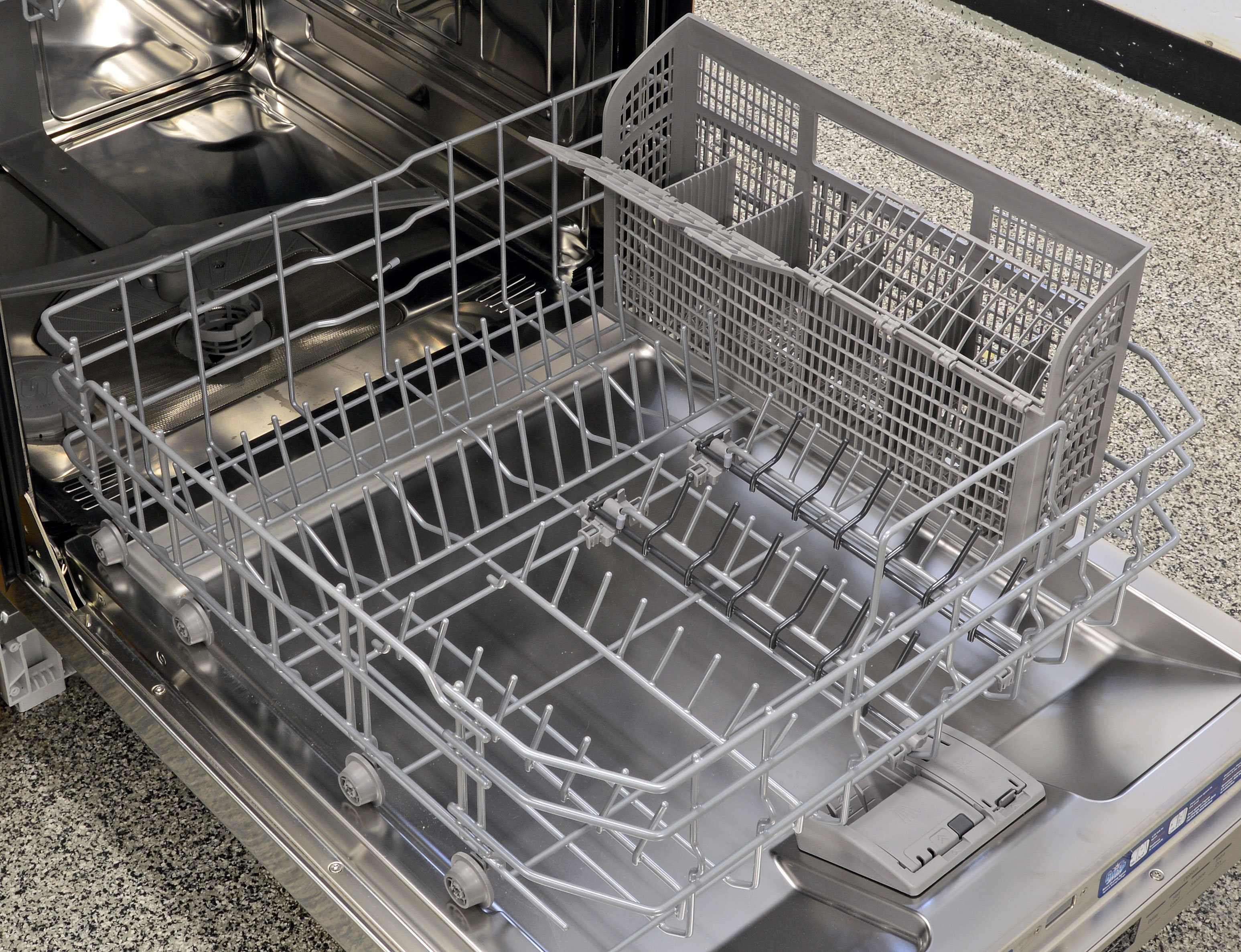 The lower rack slides in and out quite easily, and it also comes with two half rows of grey folding tines. The full-depth cutlery basket is one large unit piece.