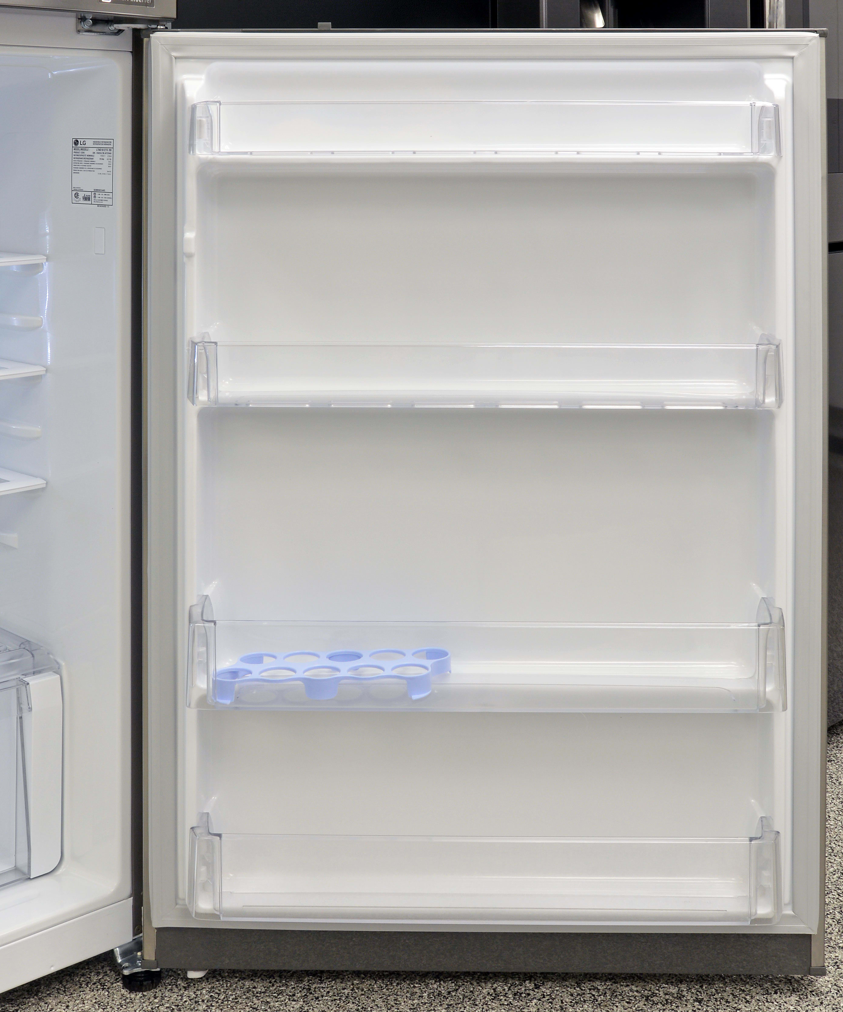 The LG LTNS16121V's door shelves can fit a two-liter bottle of soda, but are all too shallow to hold gallon jugs.