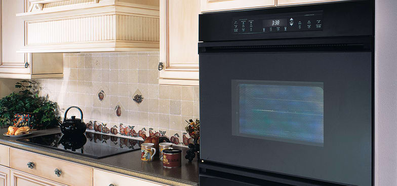 Bright country kitchen using contrasting Dacor Renaissance models, including a 36-inch, 5-element electric cooktop.