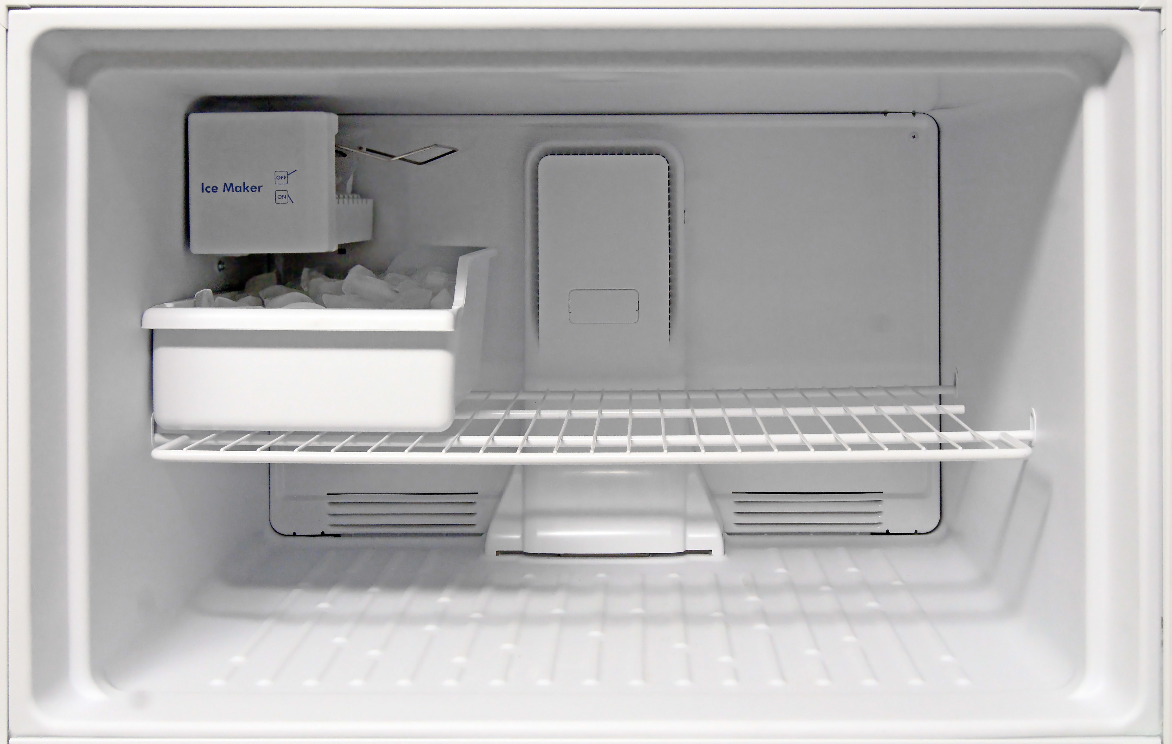 The Kenmore 72152's wide freezer is plenty spacious, though the wire shelf isn't adjustable.