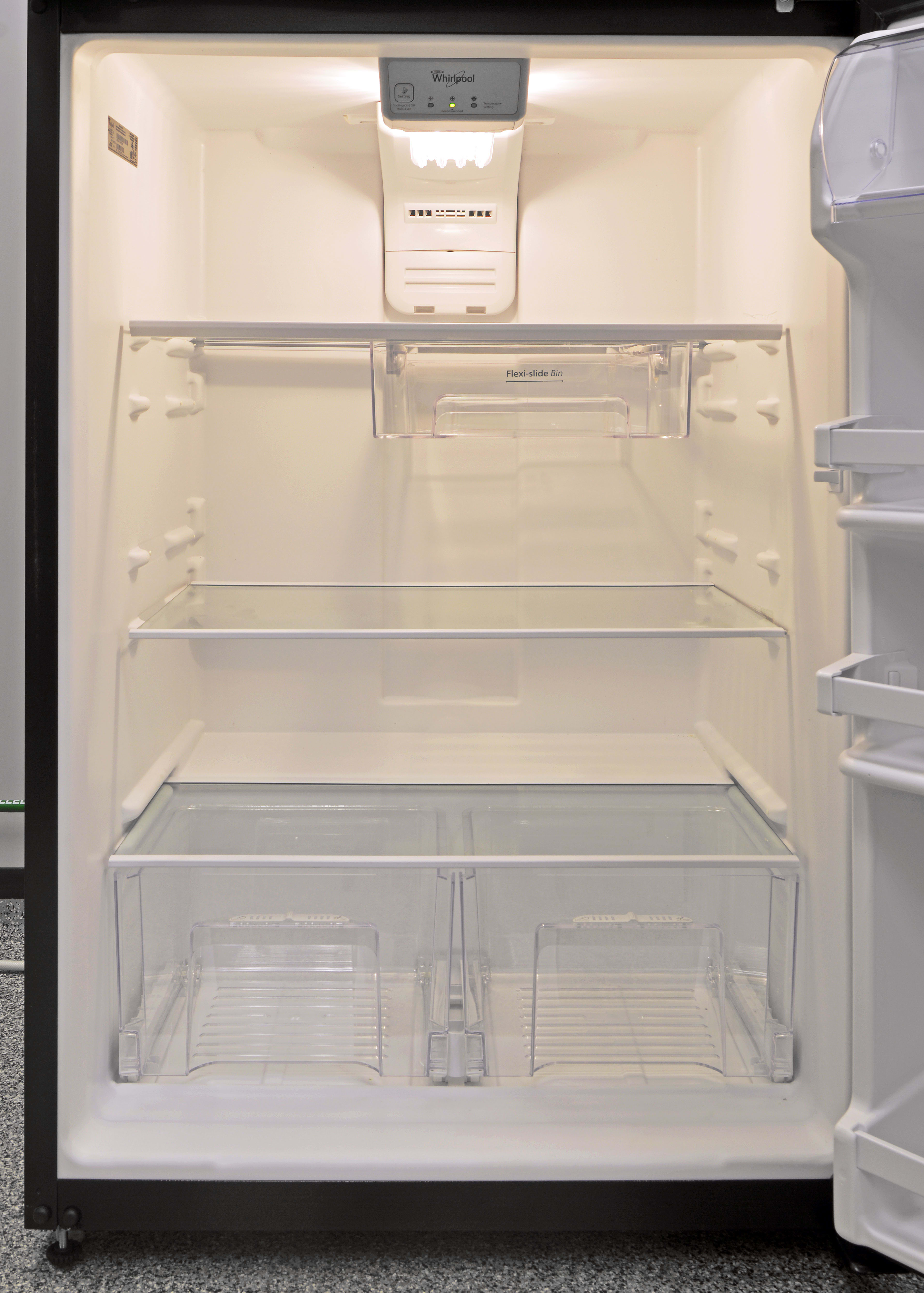 """Against the glass shelves and smooth drawers, the Whirlpool WRT318FZDB's incandescent bulb is the one design element in this fridge that screams """"budget."""""""