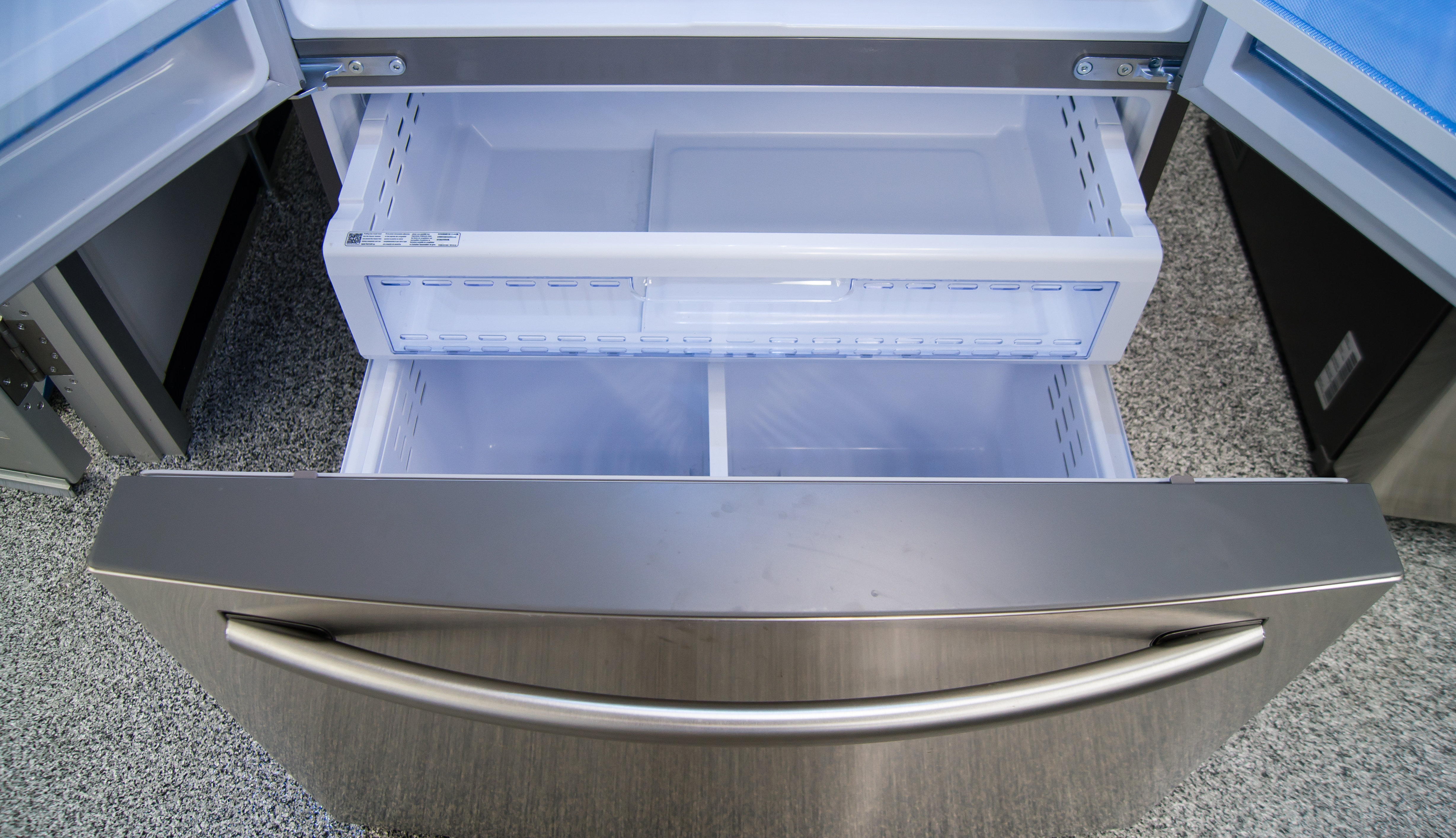 A basic pull-out freezer with two levels of storage. There's a shallow shelf hidden just inside the door of the Samsung RF28HDEDBSR.