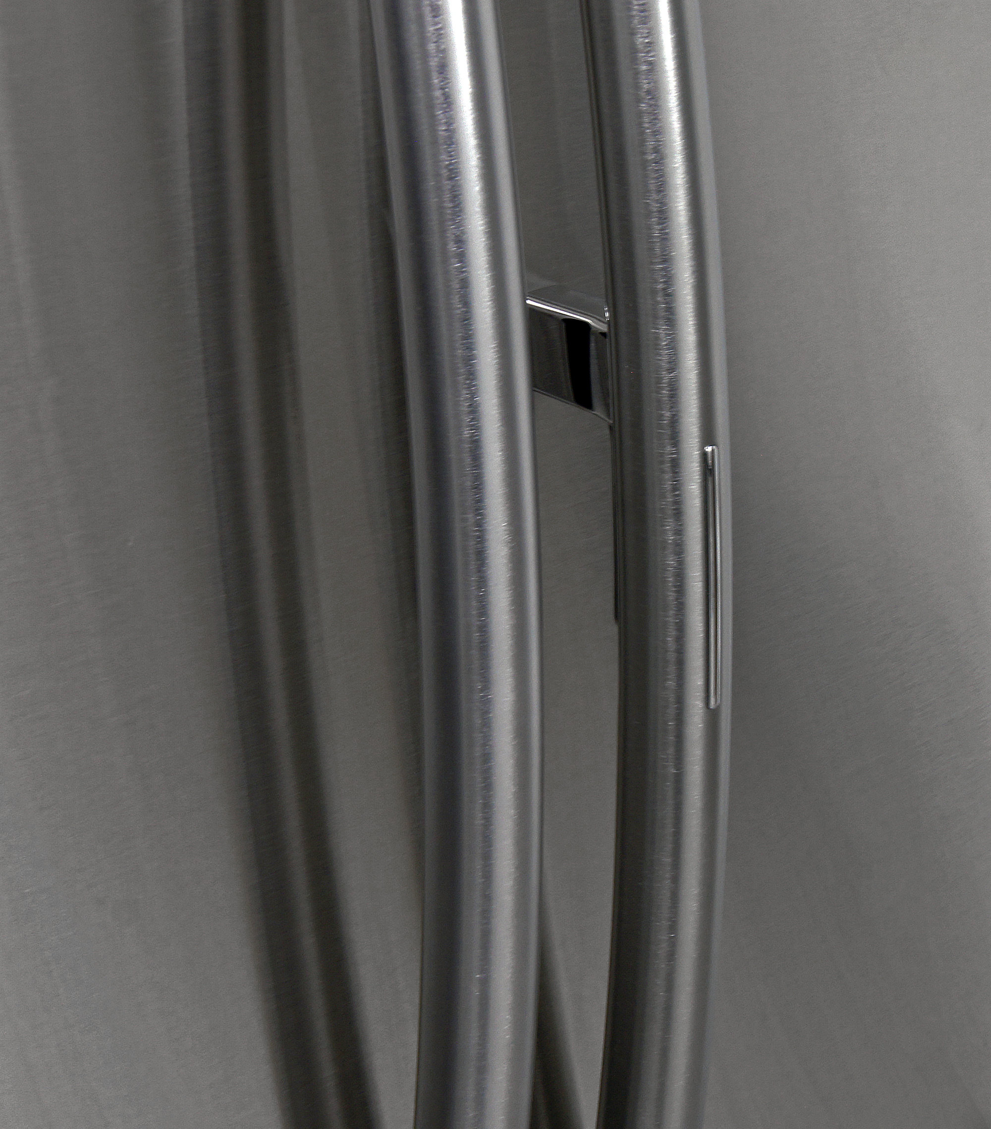 The Samsung RF23HTEDBSR's door-in-door compartment is accessed by holding down this trigger on the regular door handle.