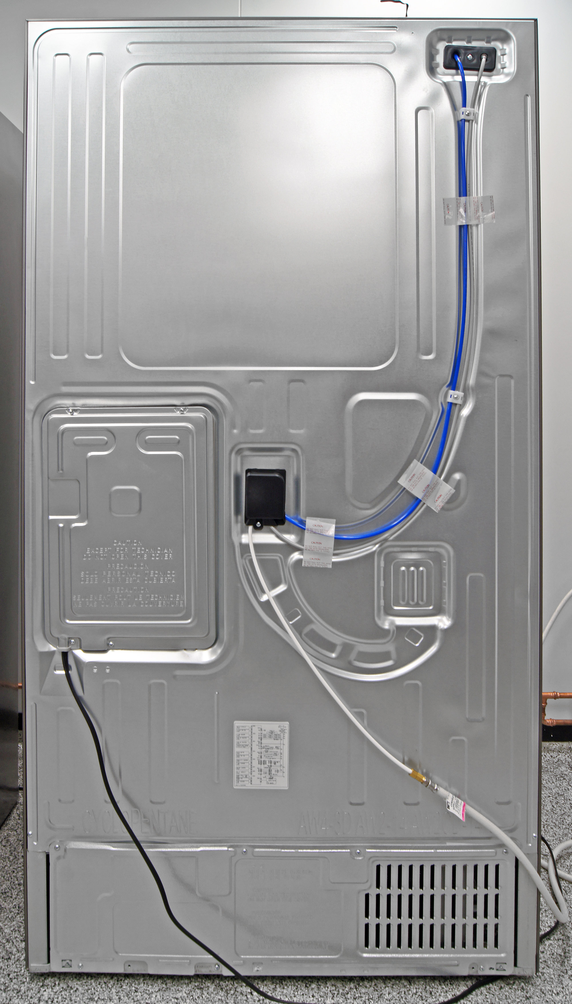 In back, you find the Samsung RF23HTEDBSR's power cable and the water input.