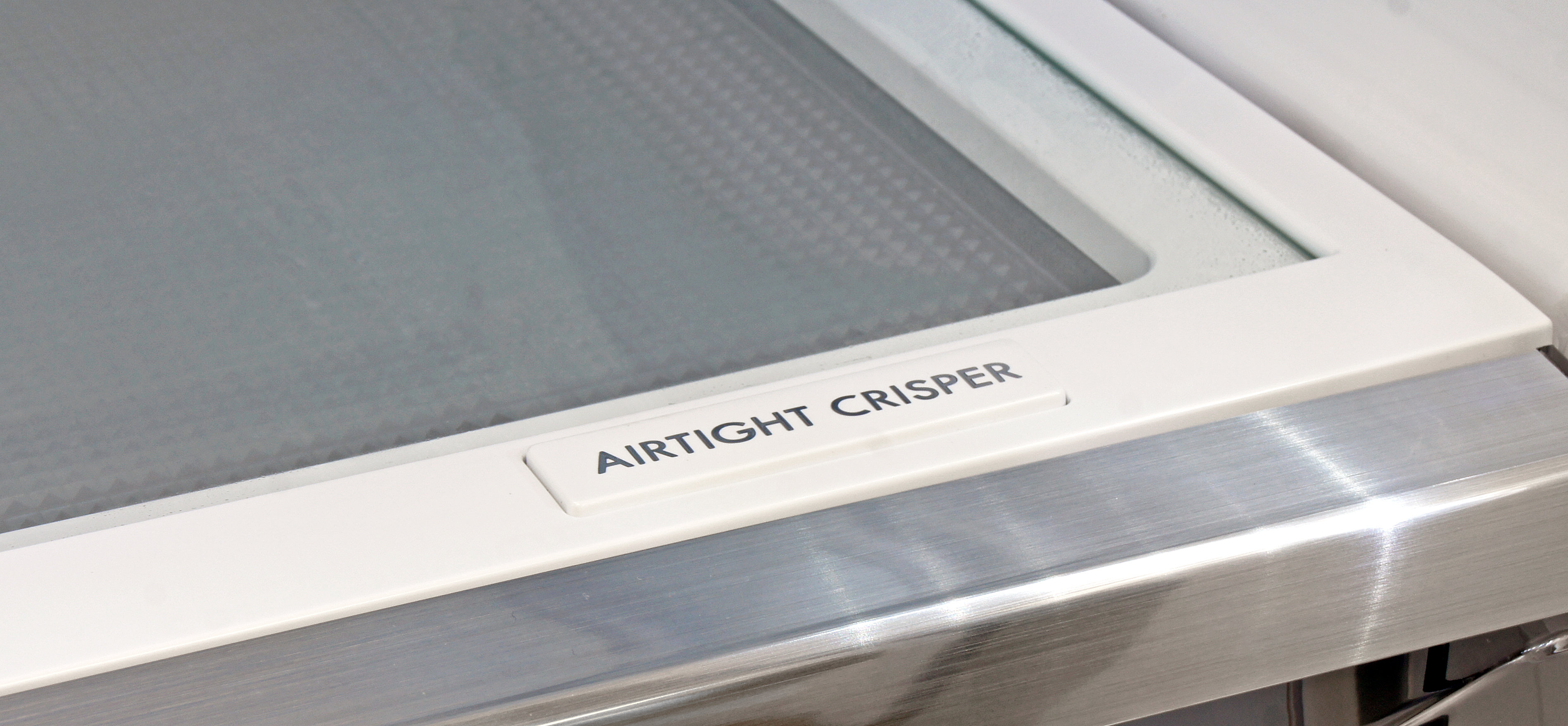 The Kenmore Elite 74025's airtight crisper has a special insulation layer that you can see through the glass shelf above it.
