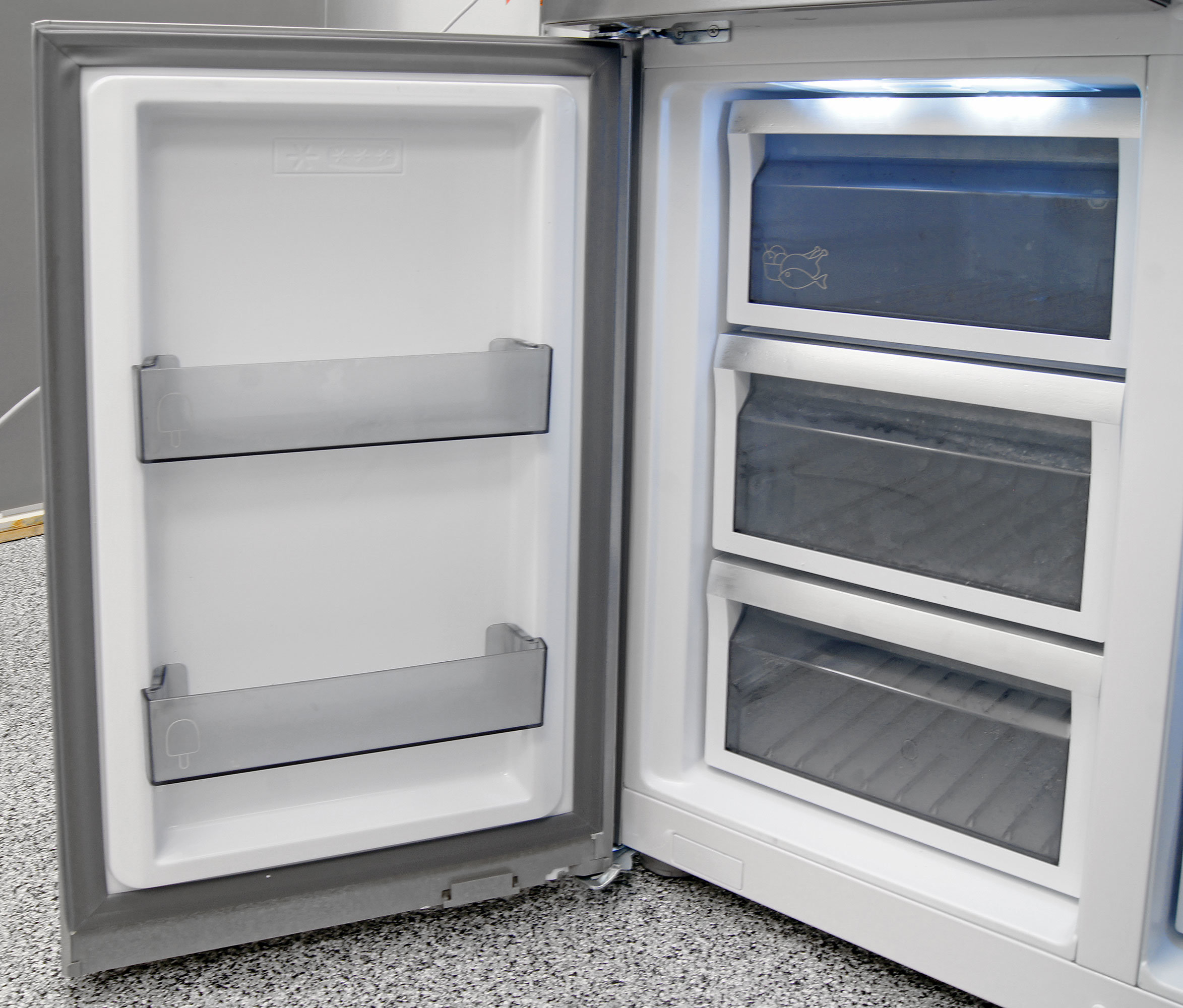 The Dacor DTF364SIWS's left freezer section is made up entirely of drawers, with two shallow shelves on the door.