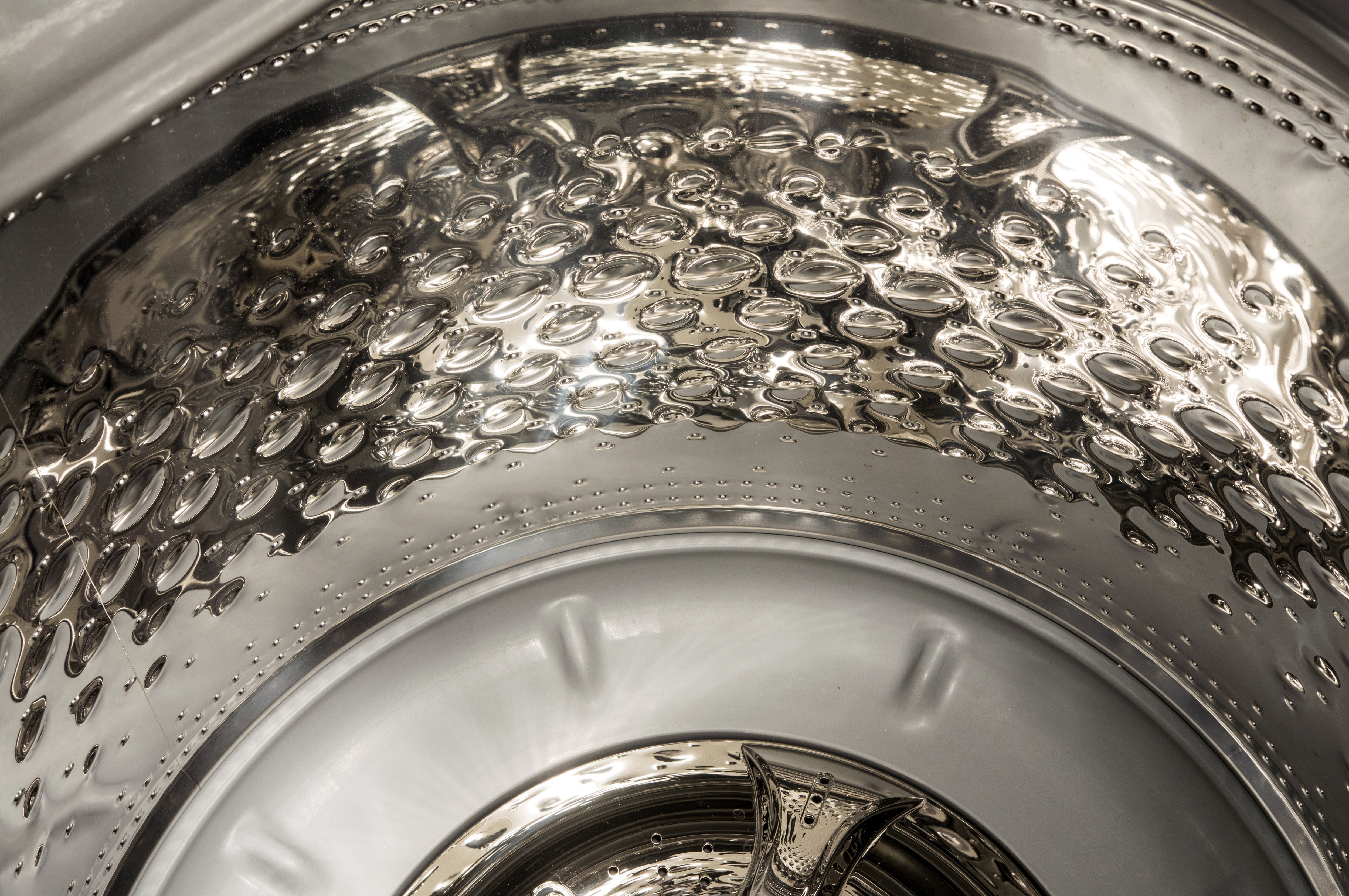 Steel bubbles on the side of the drum help scrub your clothes without destroying them.