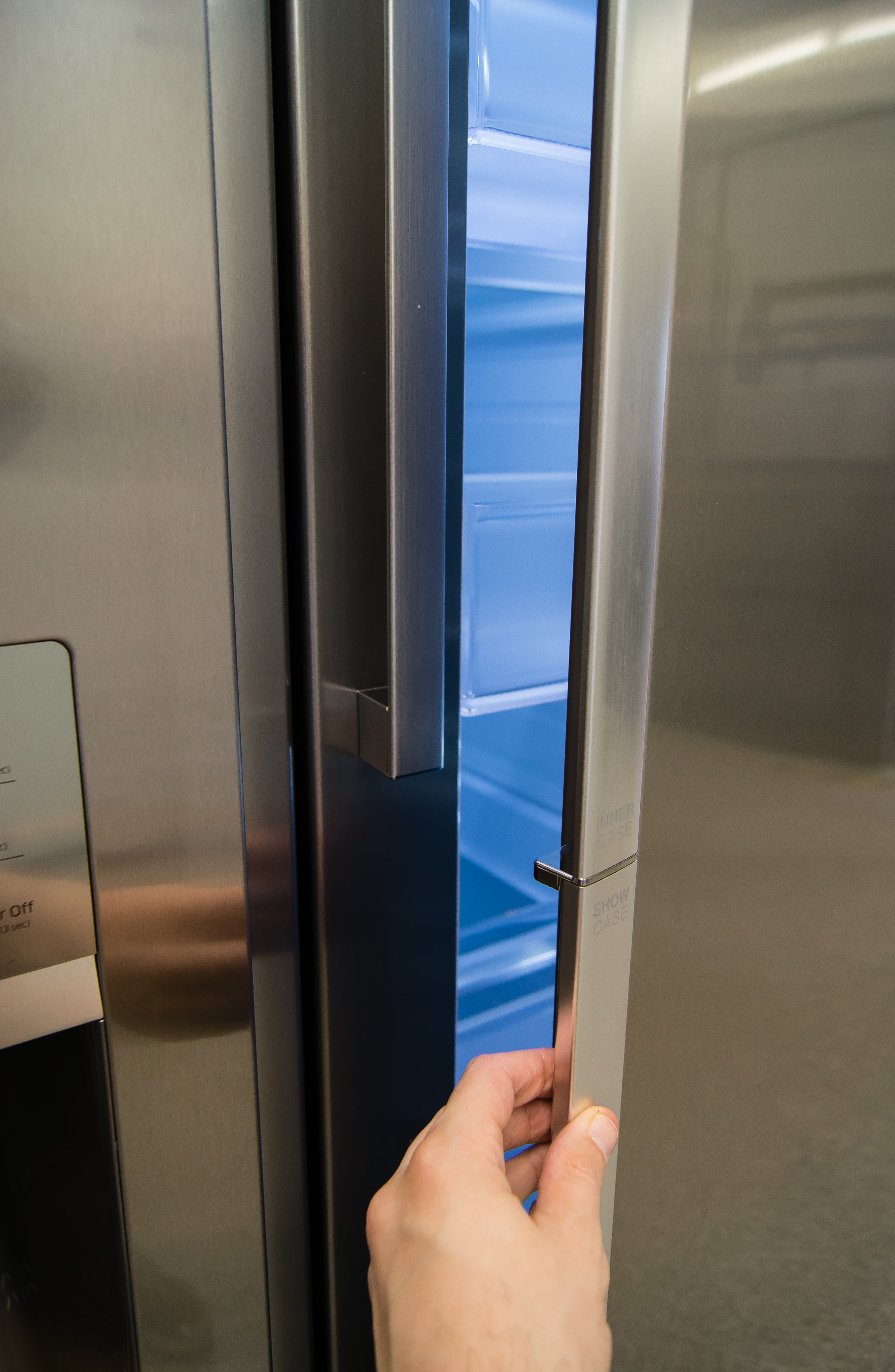Door-in-door storage is accessed by pulling on the lower portion of the Samsung RH29H9000SR Food Showcase's divided fridge door.