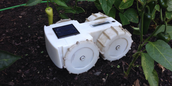 This adorable robot is a tiny solar-powered weed wacker
