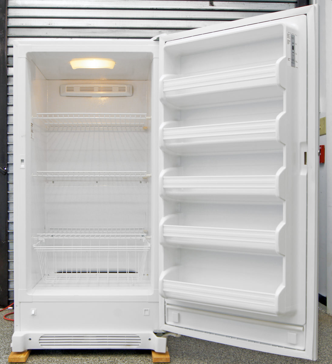 kenmore upright freezer model 253. like most budget uprights, none of the shelves in this freezer are adjustable. kenmore upright model 253 c