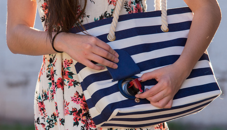 This wine-dispensing beach bag is the answer to your summer ...