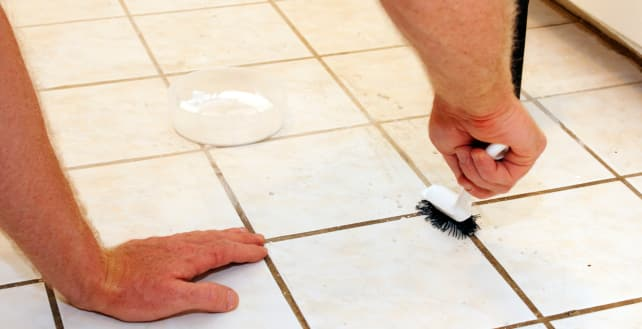 Cleaning tile with a brush